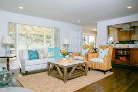 crate and barrel living room tropical living room with hardwood floors by luke stephens