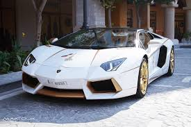 bugatti gold and white meet the one off gold plated lamborghini aventador roadster qatar