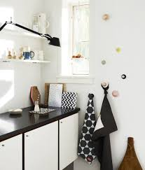 scandinavian home decor with minimalist black and white cabinet