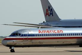 american airlines passenger dies after falling unconscious in