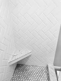 white beveled subway tile herringbone pattern marble hexagon