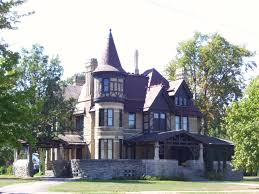 the otherworldly family is watching linda maye adams front view of the havilah babcock house a queen anne style house with a tower