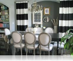 vintage dining room with black white striped curtain panels and