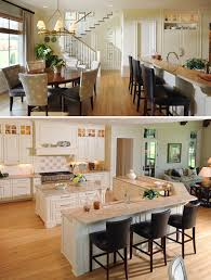 great open concept kitchen living space with wide plank dark
