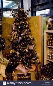 black xmas christmas tree with gold u0026 silver decorations stock