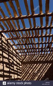Brick Walls by Shadows Of Timber Beams And Wood Ceiling Slats On Mud Brick Walls