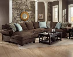 living room sectional couches with brown wooden floor and brown