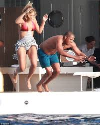 Jay Z Diving Meme - this picture was taken by paparazzi while enjoying a vacation with