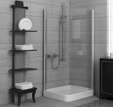 modern shower design corner square glazed shower areas with black wooden shelves on