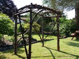 wedding arches made of tree branches tree branch arbor maybe make a bigger version as a pergola