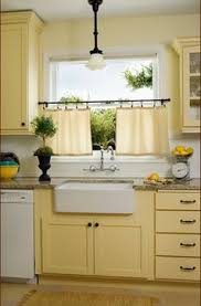 Yellow Kitchen Cabinets - butter yellow cabinets with white walls and sub tile donna