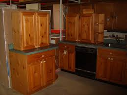 staring into the light pine kitchen cabinets and appliances for