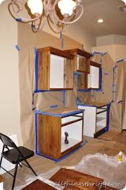 How To Repaint Kitchen Cabinets White by Learn To Paint A Cream Cabinet With Glaze Cream Kitchen Cabinets