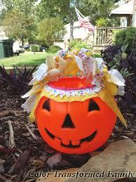 plastic pumpkins decorating a plastic pumpkin color transformed family