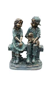 girl and boy sitting on bench with puppy statue walmart com