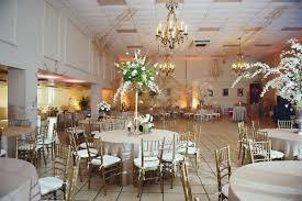 gold chiavari chairs rental gold and white wedding themes