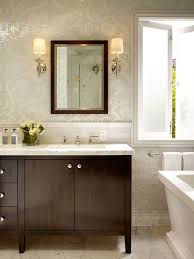 brown bathroom vanity with brown wood framed mirror traditional