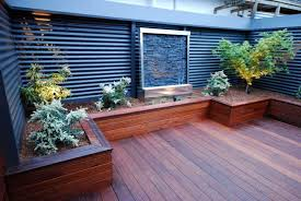 Backyard Decks Ideas Small Backyard Deck With Garden And Water Fountain Design Idea