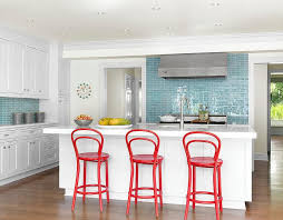 blue center island with cream kitchen cabinets eclectic