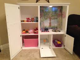 kids kitchen upcycled from old oak entertainment center my stuff