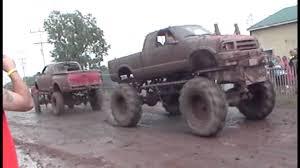 Ford Trucks Mudding Lifted - chevy vs ford mega mud truck tug o war youtube