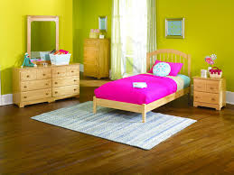 brown wooden low profile bed frame on the wooden floor in a kid u0027s