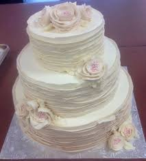 wedding cake frosting tiered rustic wedding cake with buttercream frosting and flowers