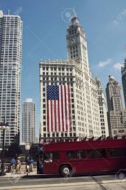 Huge Red Flag Huge American Flag On Wrigley Building In Downtown Of Chicago