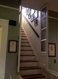 glass basement doors the doors in the stairway with wavy glass are original to the