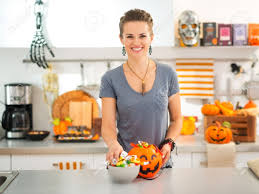 halloween candy is never too much happy young woman in decorated