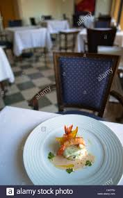 restaurant nouvelle cuisine nouvelle cuisine gourmet fish dish on a restaurant table stock photo