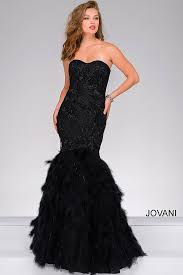 black strapless sweetheart neckline mermaid gown with a feather skirt