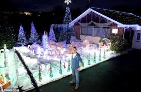 christmas light display to music near me paul toole s 20k christmas lights display flashes to the rhythm of