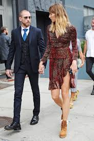 the surprising dress u0026 boot pairing we u0027re loving now