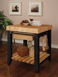 white kitchen island with butcher block top and 4 legs black