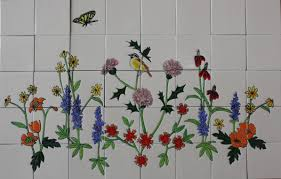 nature mexican tile mural showing a bird and a butterfly mexican