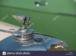 bentley car winged b badge and bonnet ornament stock