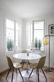 9 small space ideas to steal from a tiny paris apartment saarinen tulip table eames eiffel chairs modern small apartment living and dining room paris philippe harden