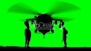 Green Yellow And Black Flag Black Hawk Helicopter Rising On Greenscreen Lizenzfreie Stock