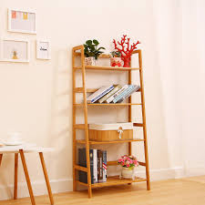 furniture accent table with wall art and leaning shelves also