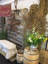 western theme party props country and western decorations for a country western party pallet backdrop rope sign draped hay bale seating