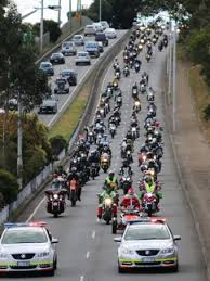 motorcycle riders rev up to deliver christmas presents in
