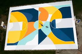 designboom italy gue turns a basketball court in italy into a labyrinth of lines and