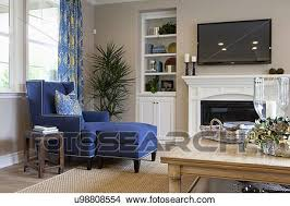 Blue Chaise Stock Photo Of Flat Screen Tv Above Fireplace With Blue Chaise
