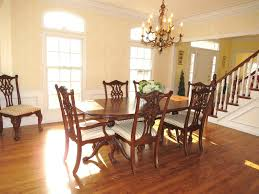 traditional dining room with wainscoting u0026 hardwood floors in