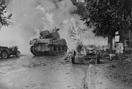 ww2 german jeep 5th armored division m4 sherman jeep passing german 75mm at gun