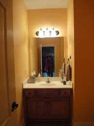 Orange Powder Room A Small Powder Room Gets A Big Makeover Design Connection Inc