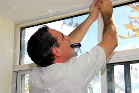 man installing window blinds in a house stock photo picture and