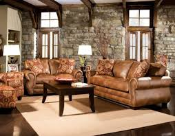 Area Rugs With Brown Leather Furniture Brown Leather Sofa In A Living Room With Area Rug And Round Silver