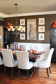 decorating with brown walls in dining room with wainscoting and
